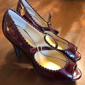 Size 9 burgundy patent leather Mary Jane pumps.